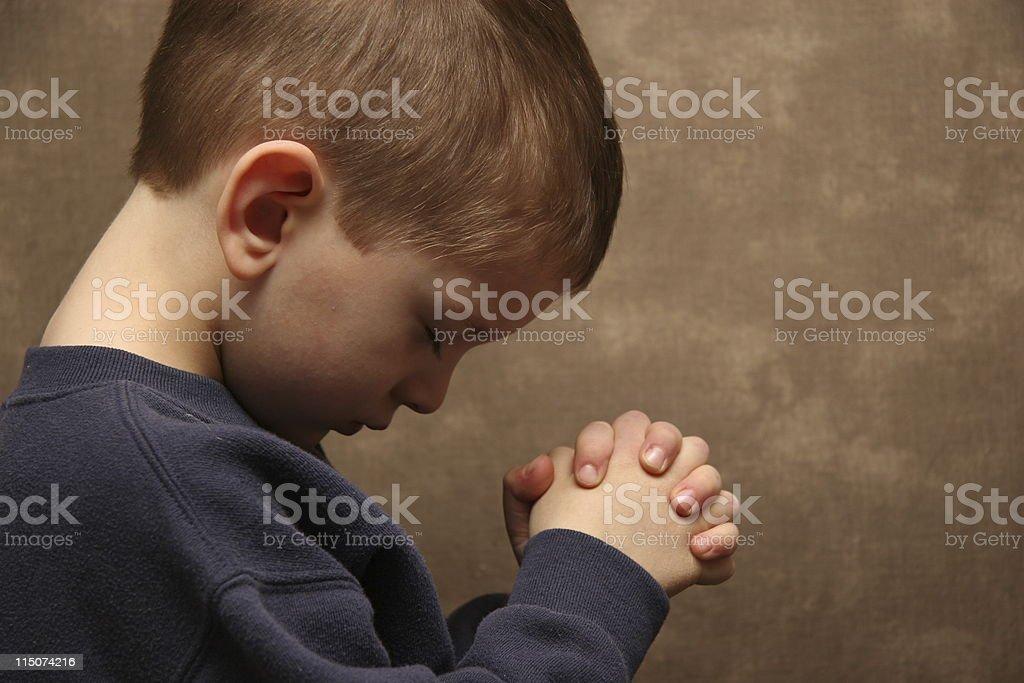 Boy praying - color royalty-free stock photo
