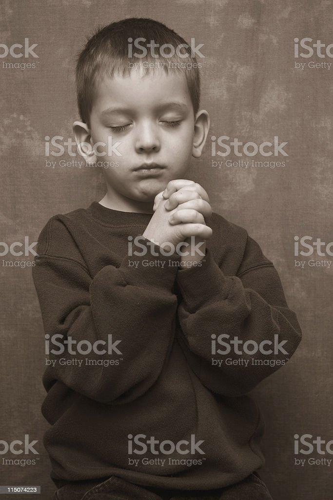Boy Praying - faces foreward stock photo