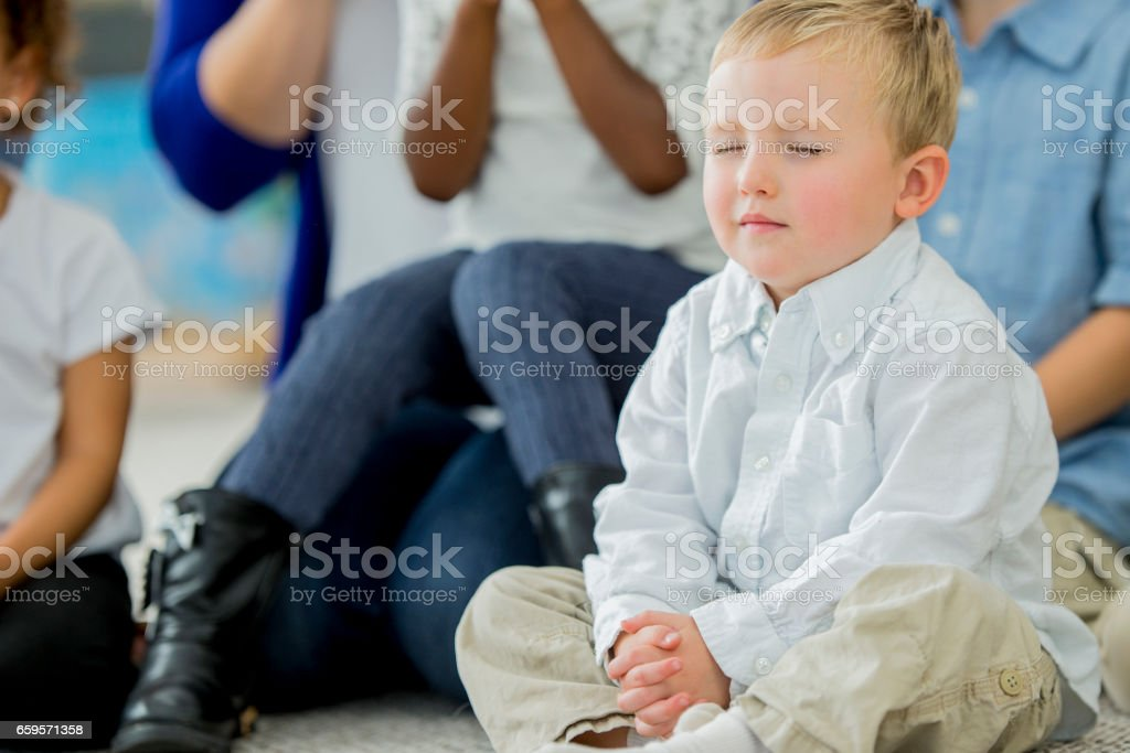 Boy praying stock photo