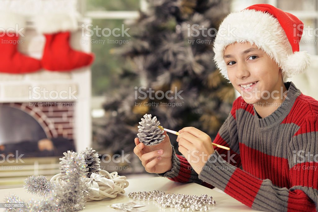 Boy preparing for Christmas stock photo