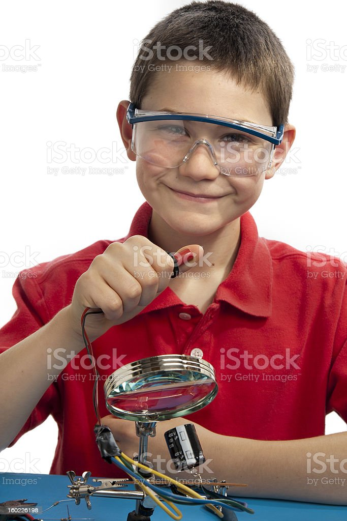 Boy pressing button on electronics gadget royalty-free stock photo
