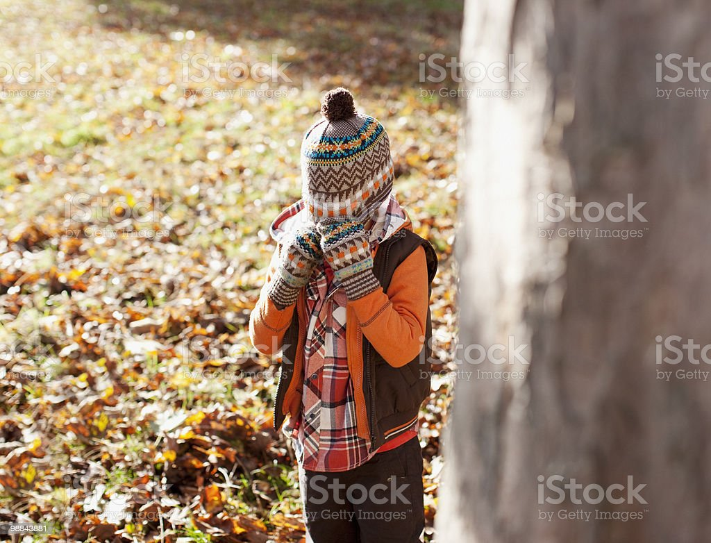 Boy pulling knit cap over his head royalty-free stock photo