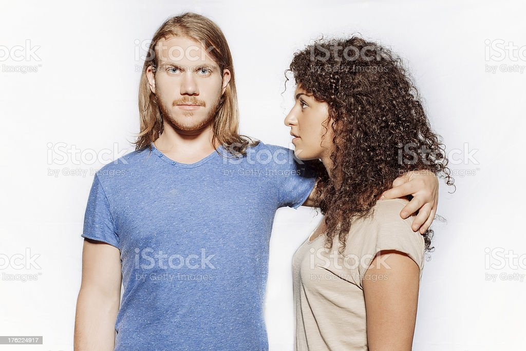 Boy puts his arm around her shoulders royalty-free stock photo