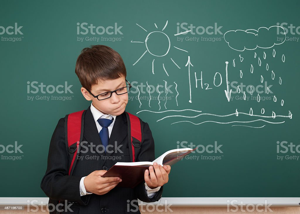 boy read book about water circulation stock photo