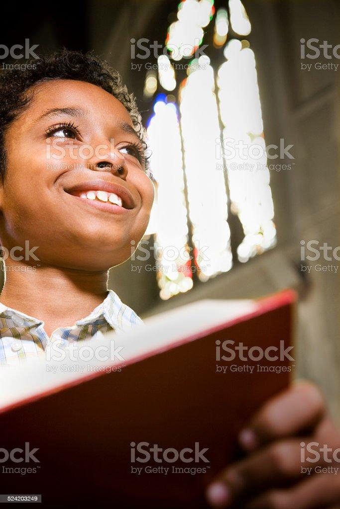 Boy Reading Bible in Church stock photo