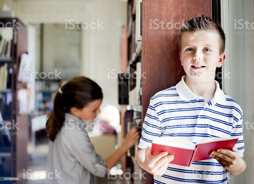 Boy Reading in a Library royalty-free stock photo