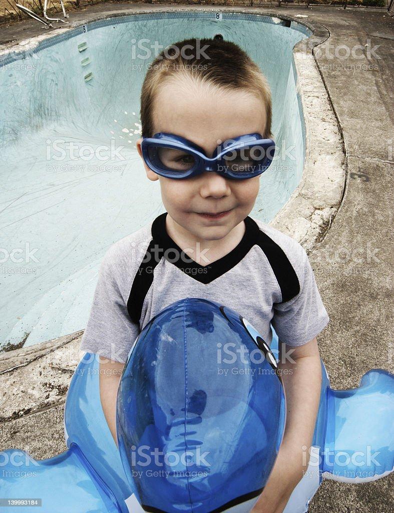 Boy Ready to Swim in Empty Pool royalty-free stock photo