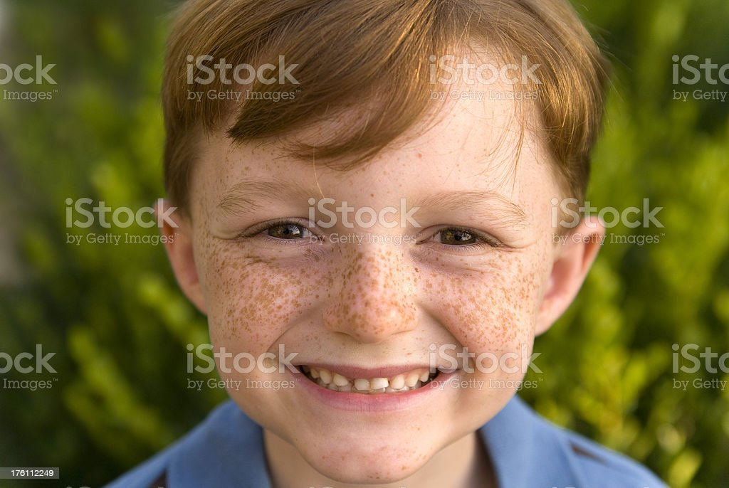 Boy Redhead About to Lose His First Teeth stock photo