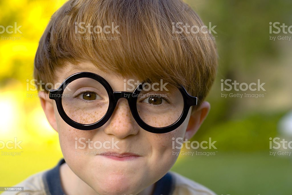 Boy Redhead Freckle Face, Child Nerd in Halloween Costume & Eyeglasses stock photo
