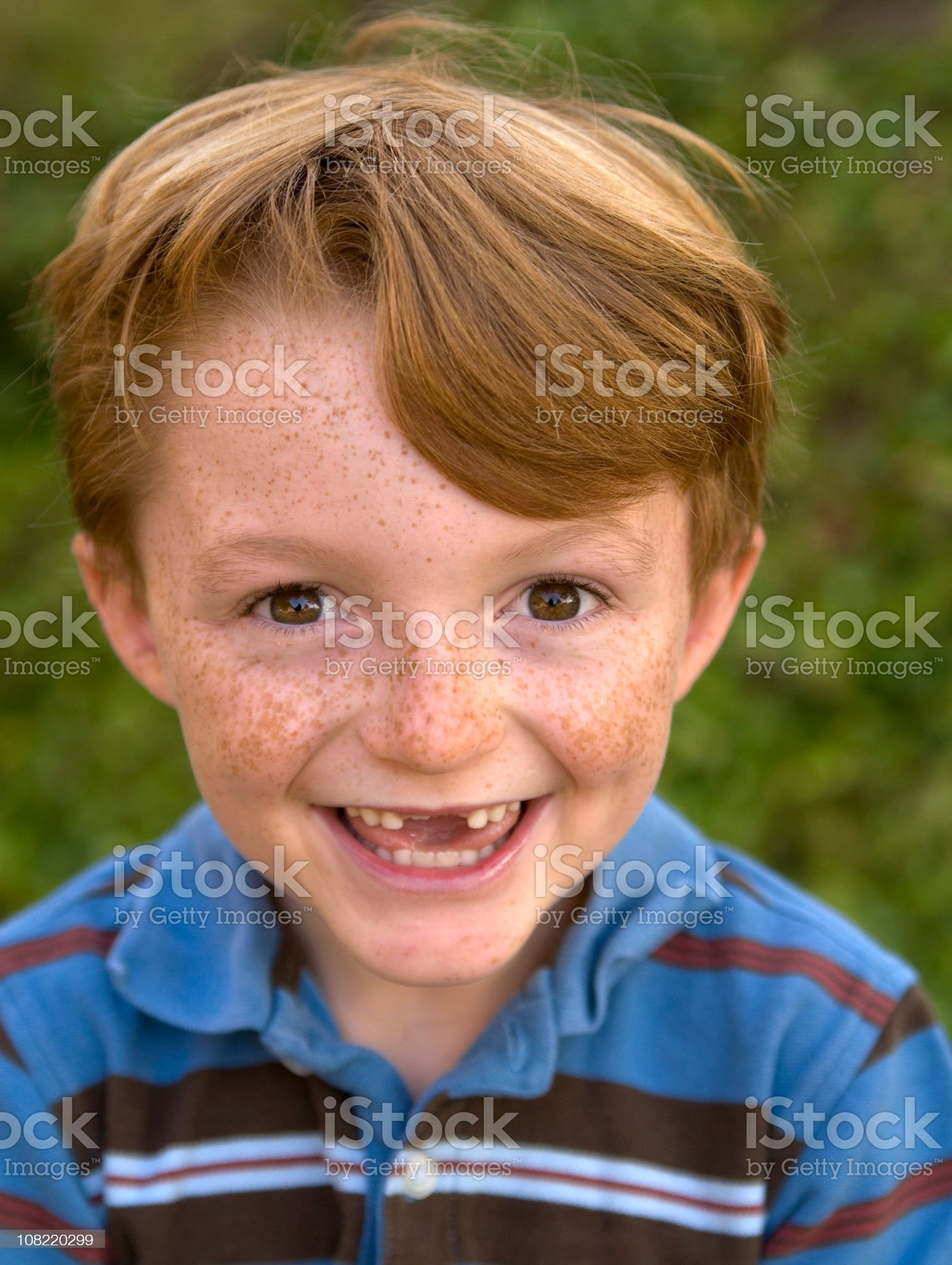 Boy Redhead Freckle Face Laughing, Child Smiling with Missing Teeth royalty-free stock photo