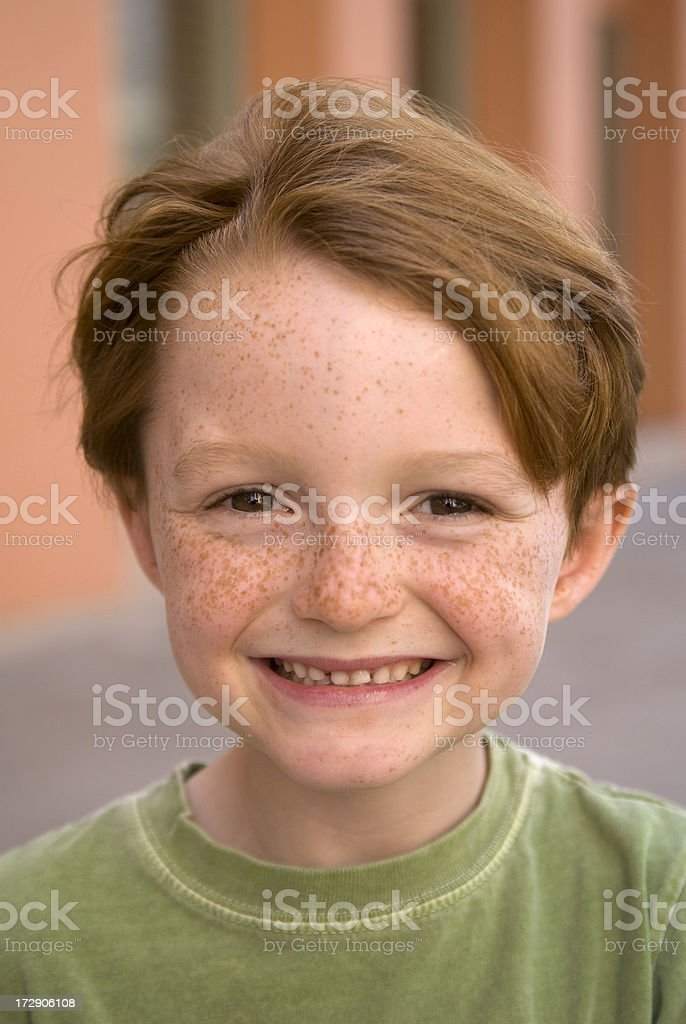 Boy Redhead Smiling, Freckle Face Child with Loose Front Teeth stock photo