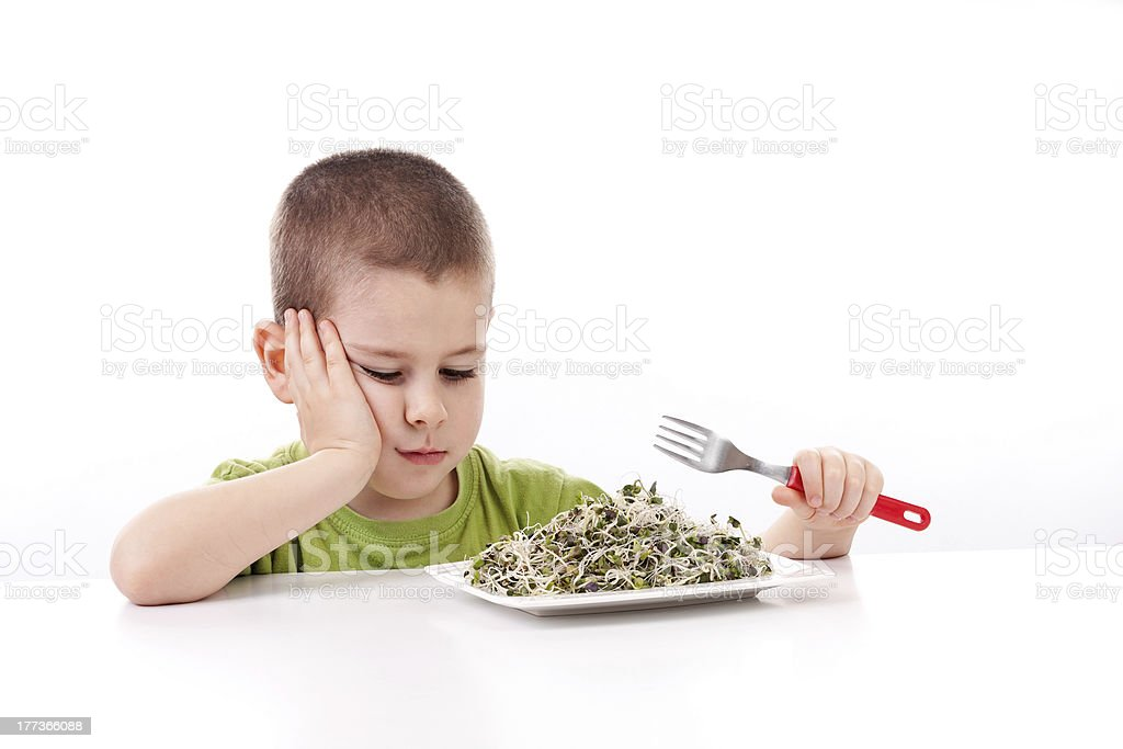 Boy refuses to eating stock photo