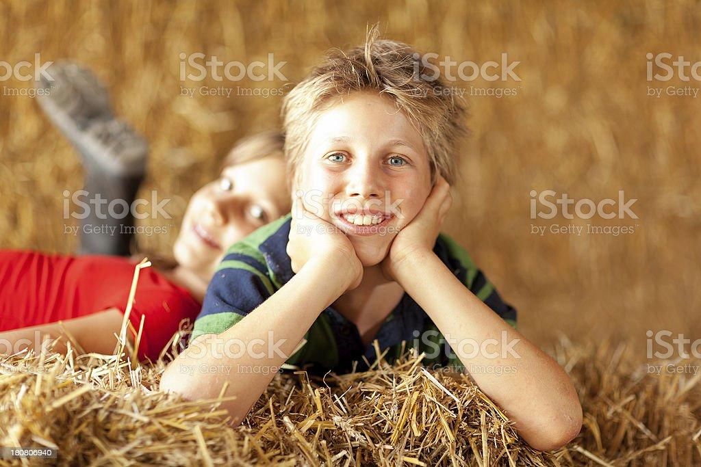 boy relaxing in straw stock photo