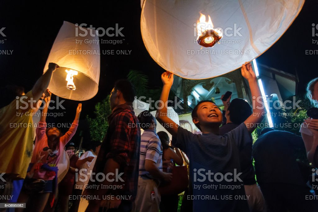 A boy releases a floating lantern in Chiang Mai, Thailand stock photo