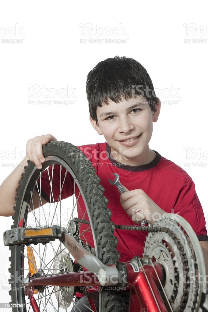 boy repairing the bicycle royalty-free stock photo