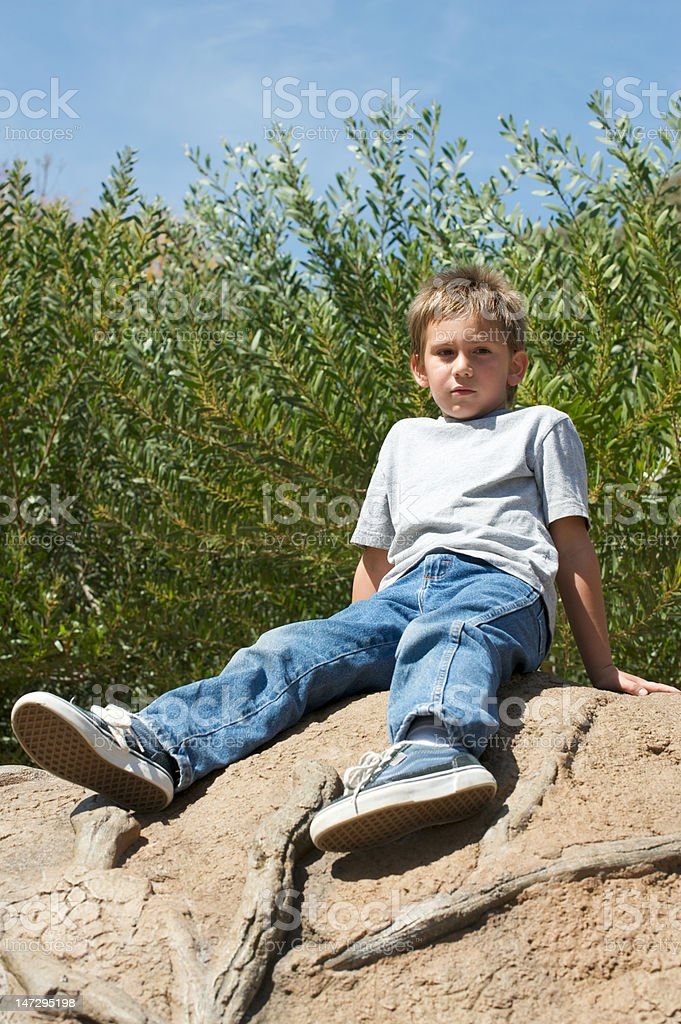 Boy resting during hike royalty-free stock photo