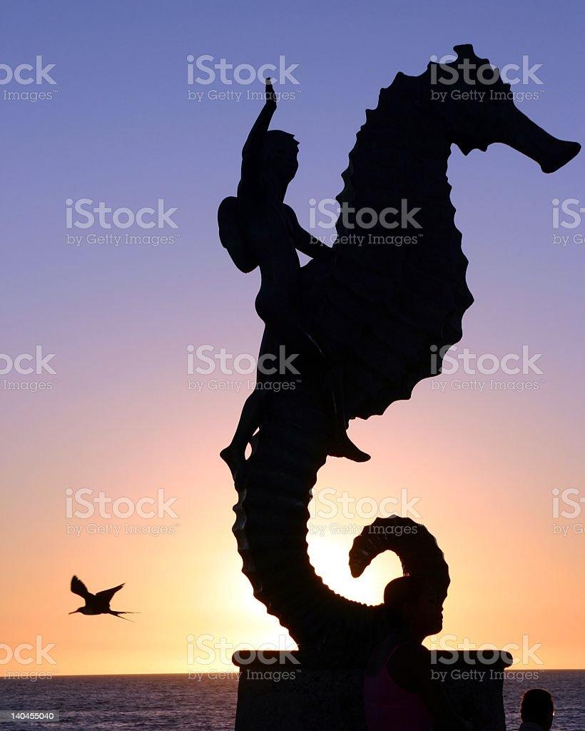 Boy Riding a Seahorse stock photo