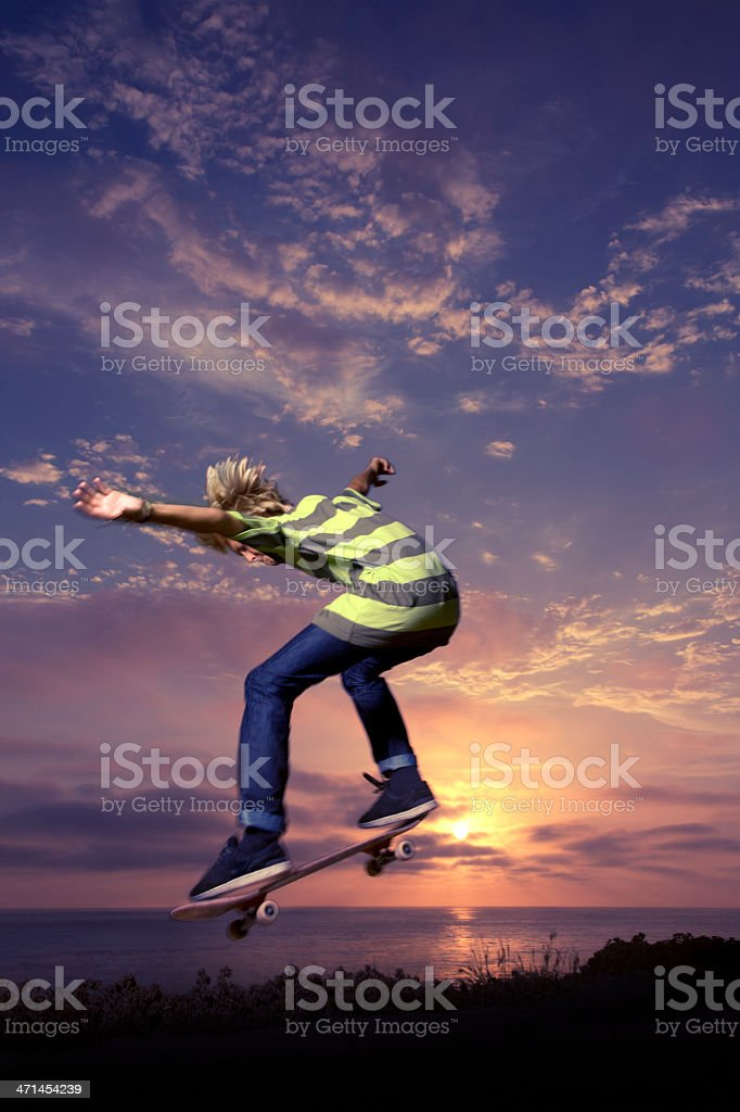 Boy Riding Jumping Over the Sun stock photo