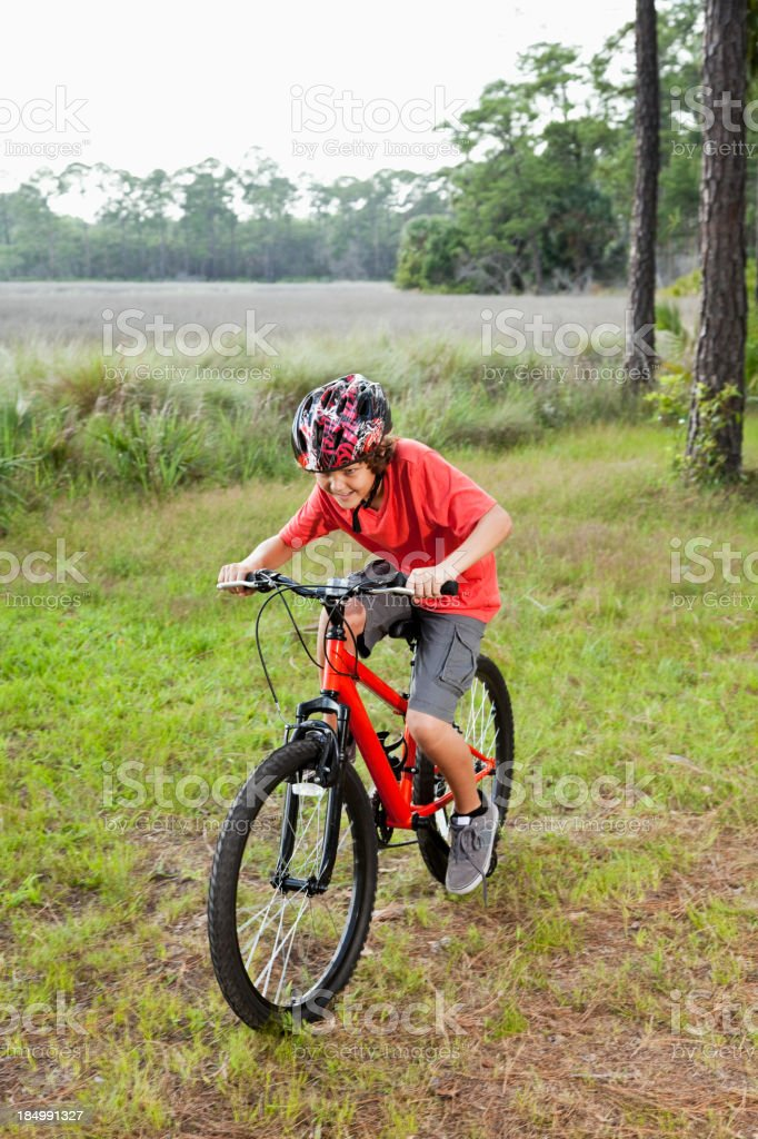 Boy riding mountain bike stock photo