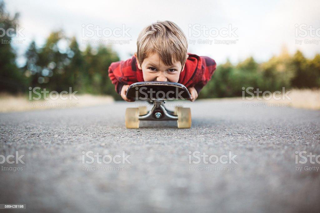 Boy Riding on Skateboard stock photo