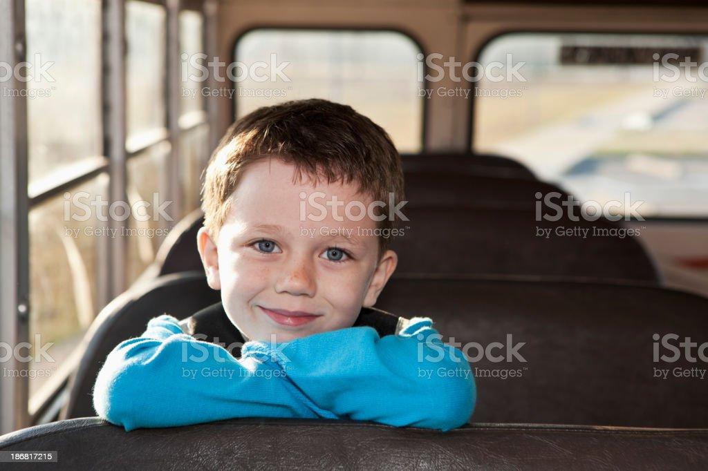 Boy riding school bus royalty-free stock photo