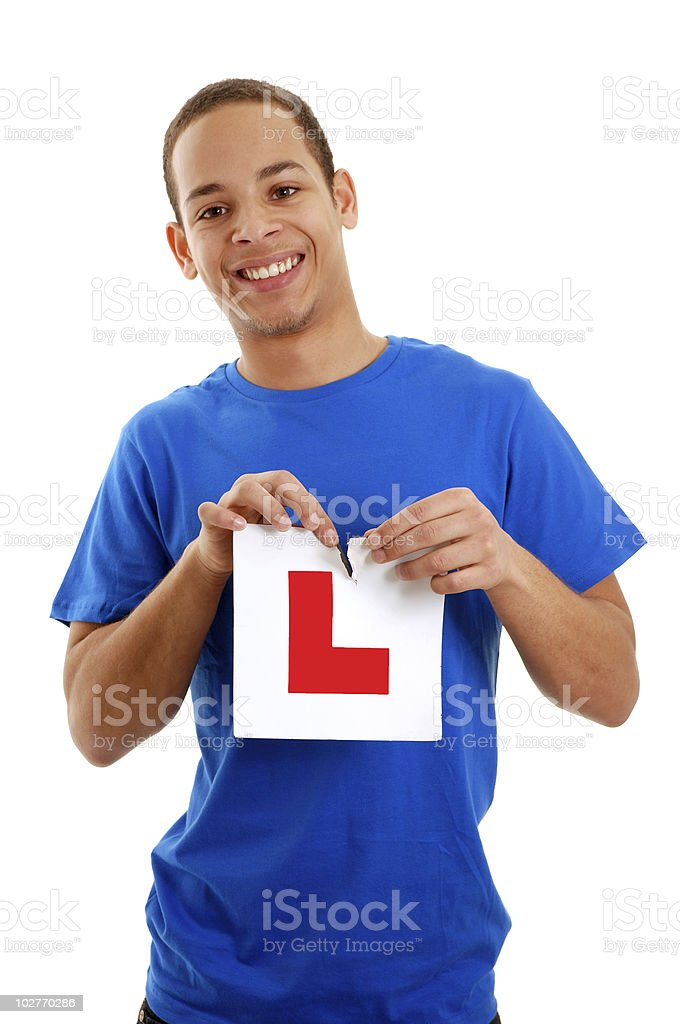 Boy ripping L plate stock photo