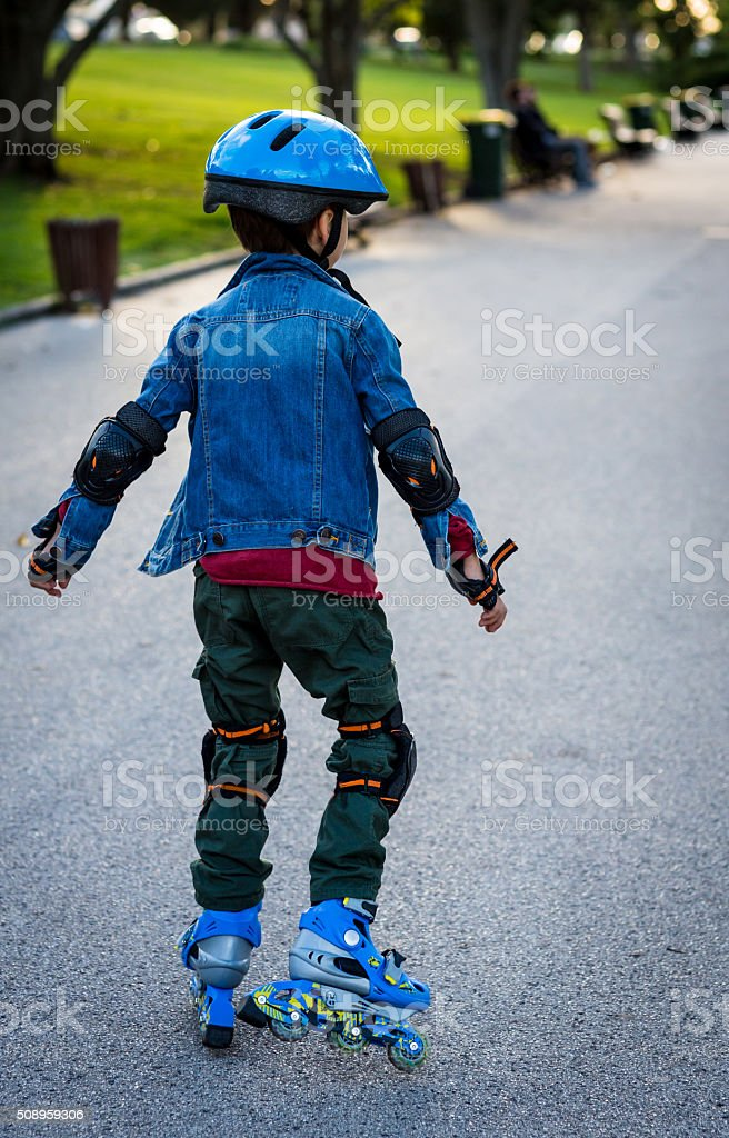 Boy roller skating stock photo