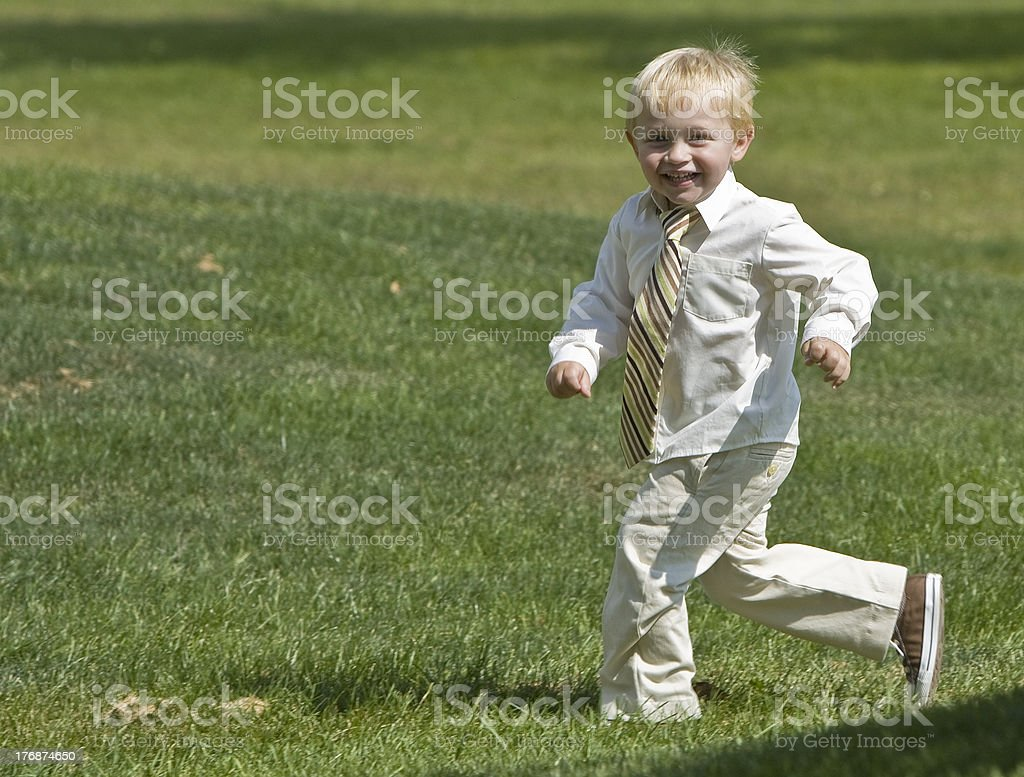 Boy Running In Grass royalty-free stock photo