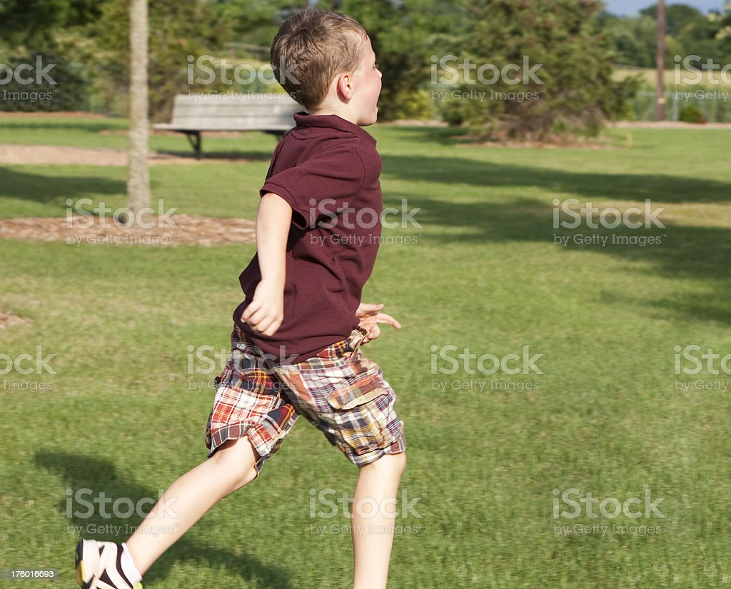 Boy Running in the Park stock photo