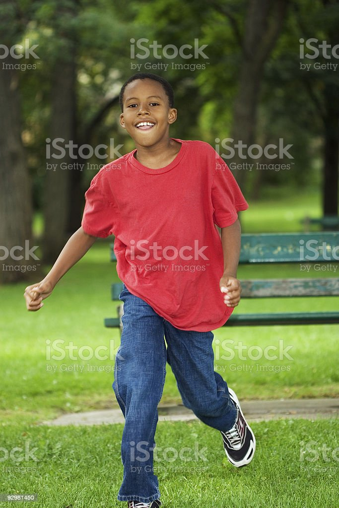 boy running out stock photo