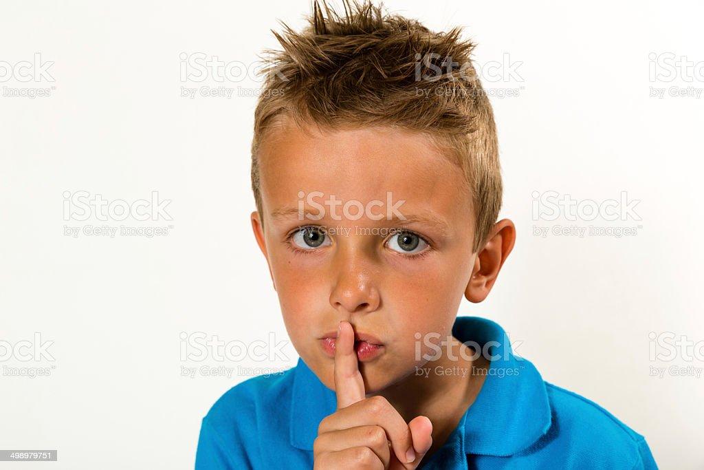 Boy saying schyyy stock photo