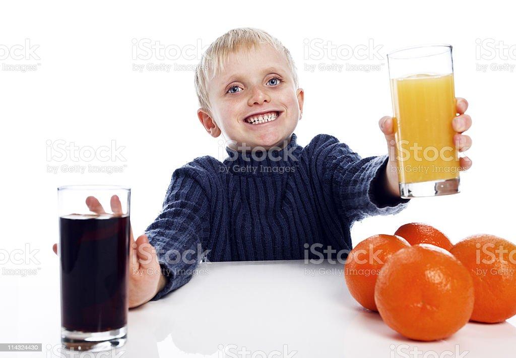 Boy says yes to healthy orange juice royalty-free stock photo