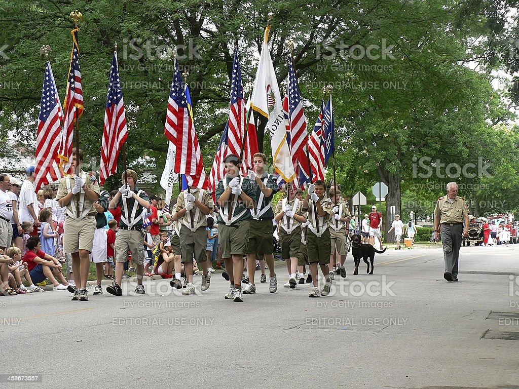Boy Scouts marching in Fourth of July parade stock photo