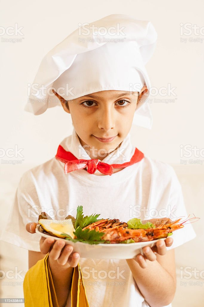 Boy Serving Food with Chef Hat royalty-free stock photo