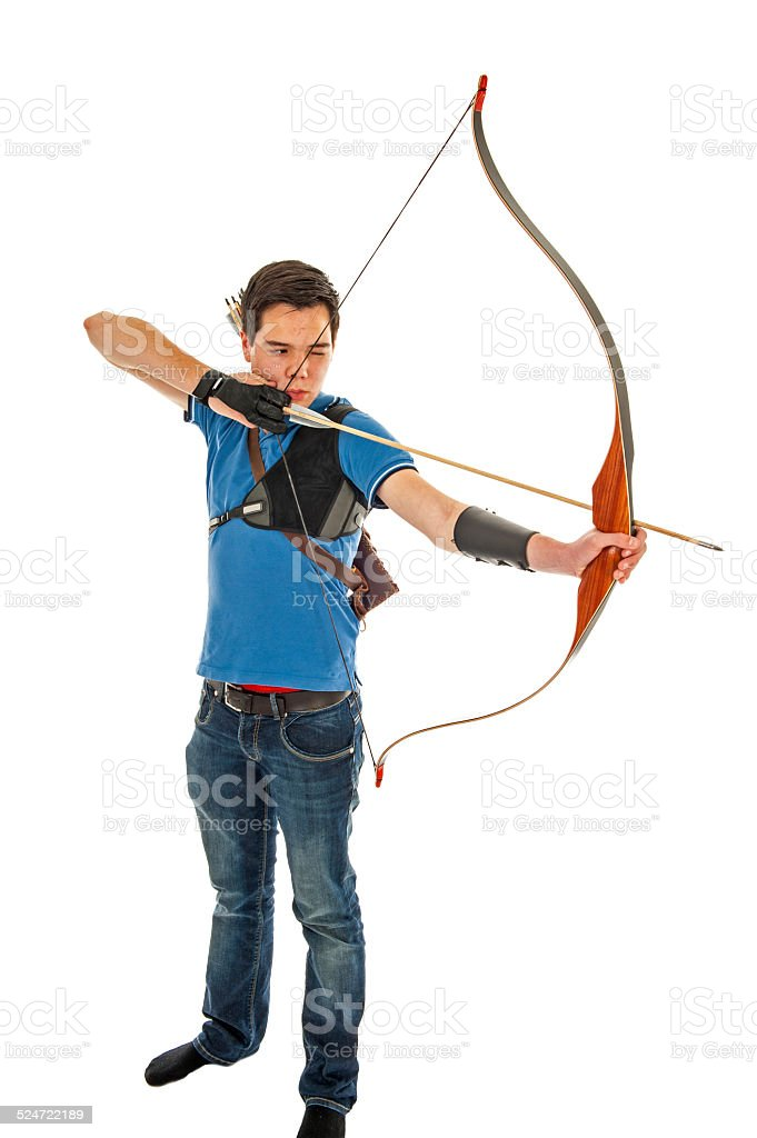 Boy shooting with bow and arrow stock photo