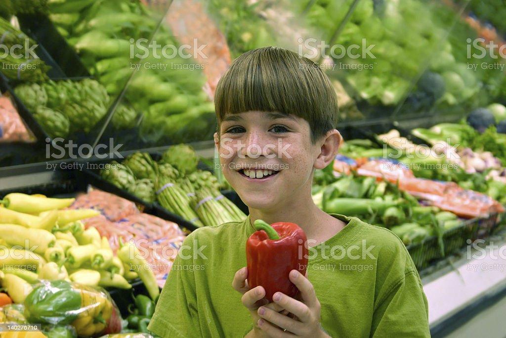 Boy Shopping in Produce royalty-free stock photo
