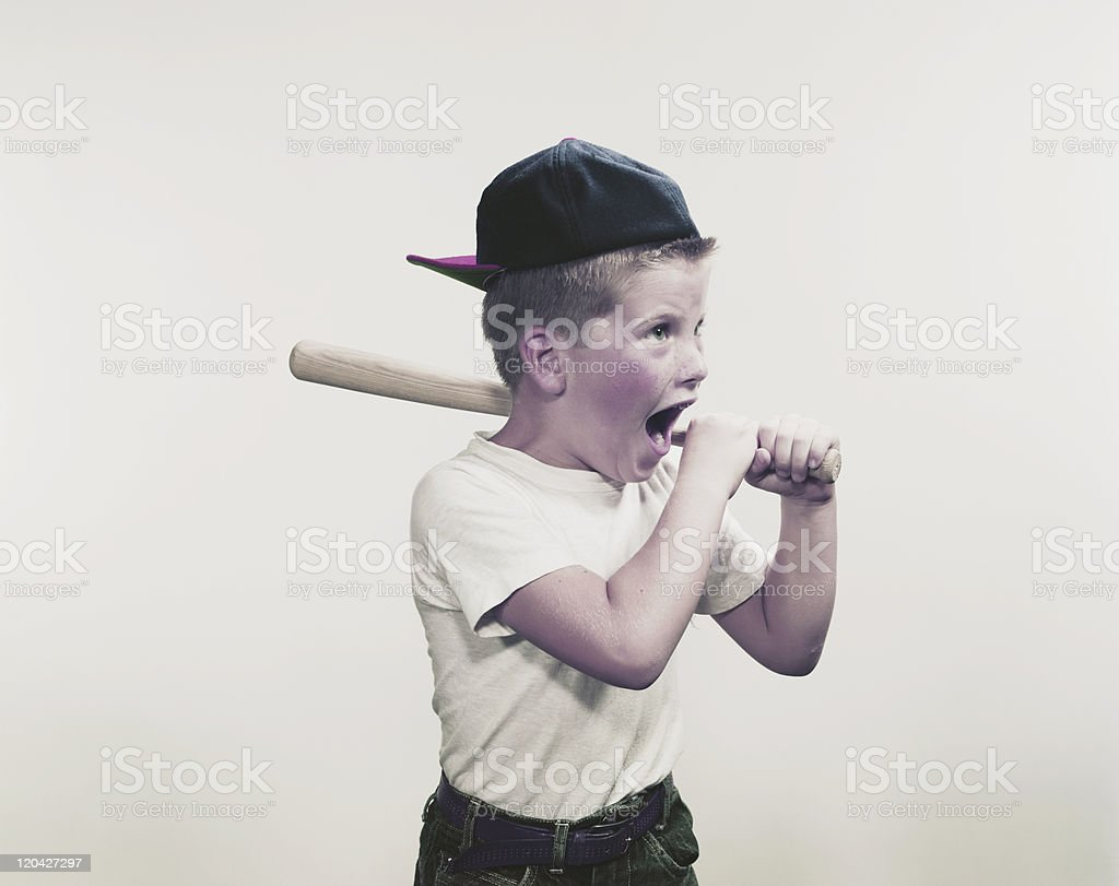 Boy shouting and holding baseball bat  royalty-free stock photo