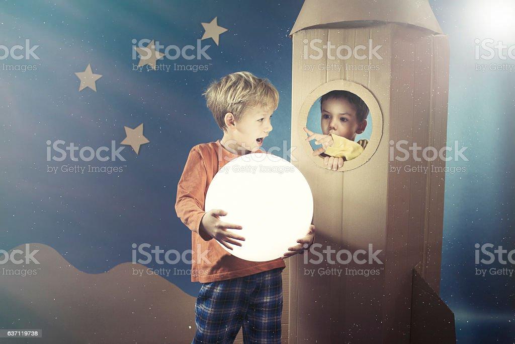 Boy showing the shining ball stock photo
