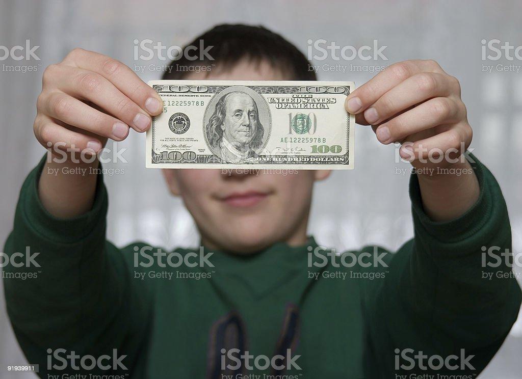 boy shows 100 dollars royalty-free stock photo
