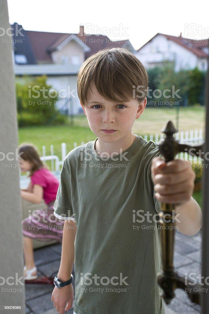 Boy Sibling Rivalry Conflict Door royalty-free stock photo