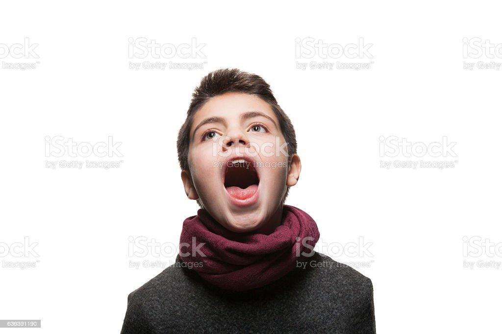 Boy sings in the studio stock photo