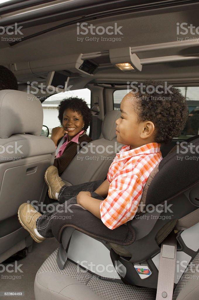 Boy Sitting in Car Seat stock photo