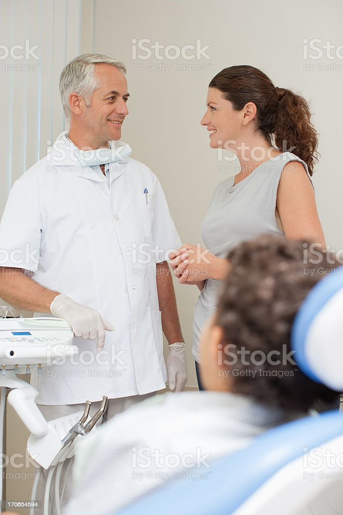 Boy sitting in dentist's chair royalty-free stock photo