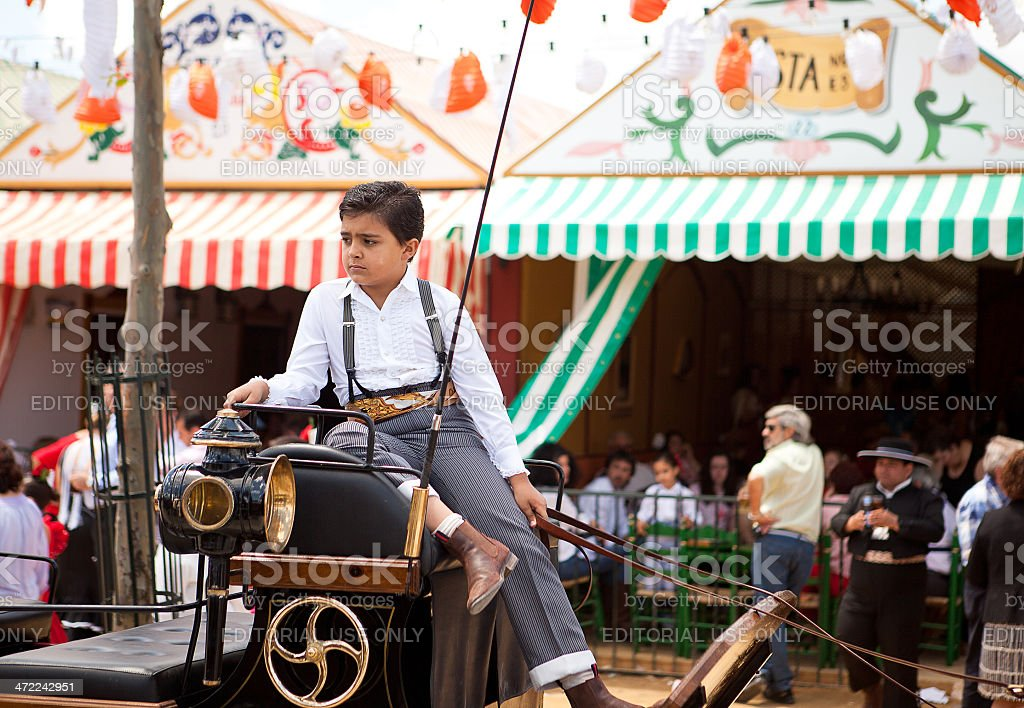 Boy sitting on a horse carriage stock photo