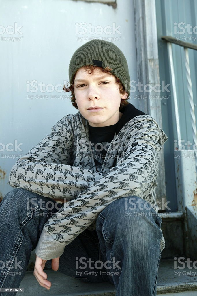 Boy Sitting on Old Stairs royalty-free stock photo