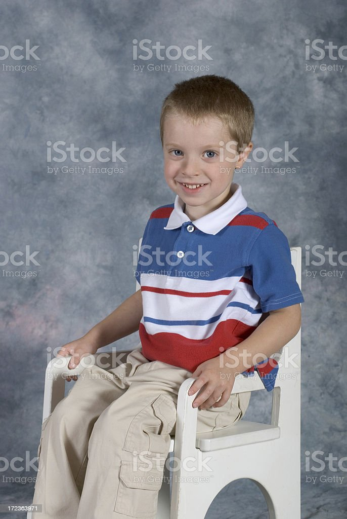 Boy Sitting School Pose royalty-free stock photo