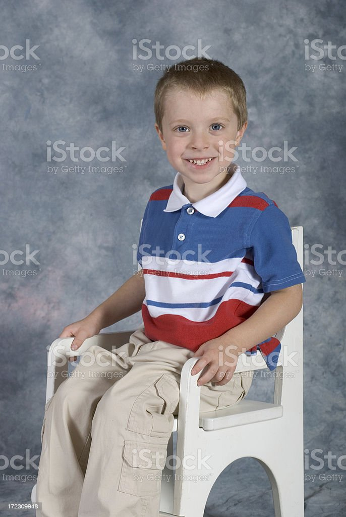 Boy Sitting School Pose Straight On royalty-free stock photo