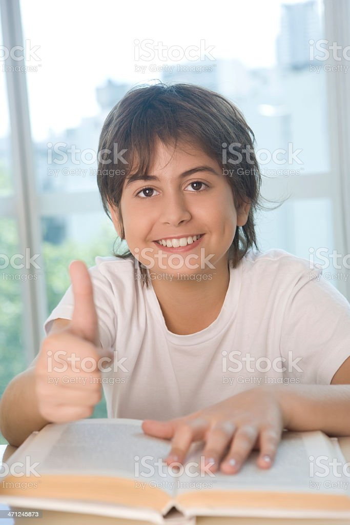 Boy sitting with Textbook royalty-free stock photo