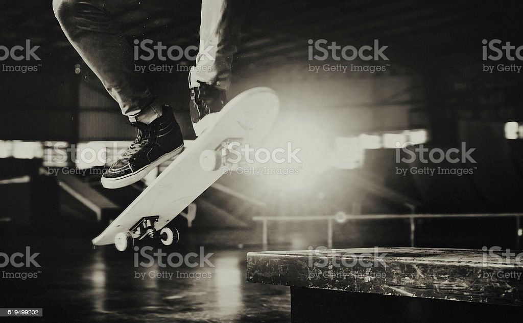 Boy Skateboarding Jump Lifestyle Hipster Concept stock photo