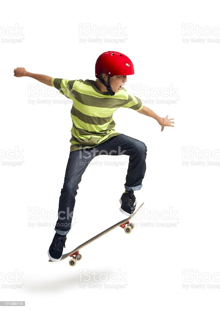 Boy Skateboarding on a White Background stock photo